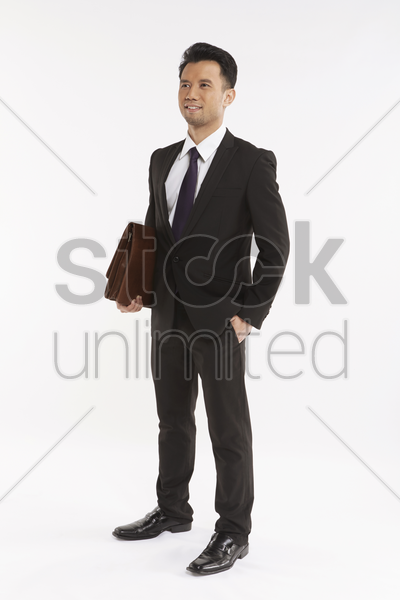 businessman carrying a briefcase stock photo