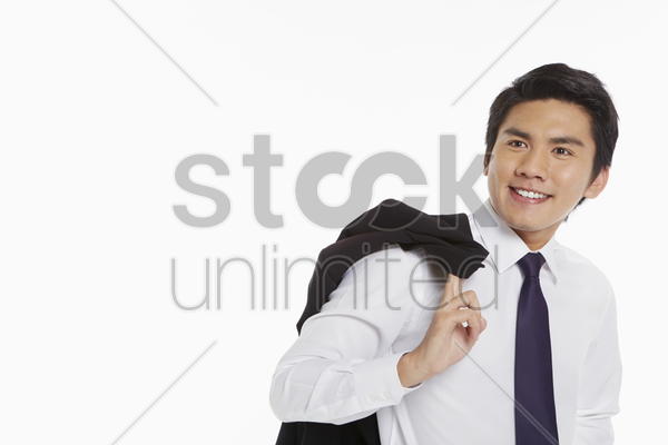 businessman carrying a jacket over his shoulder stock photo