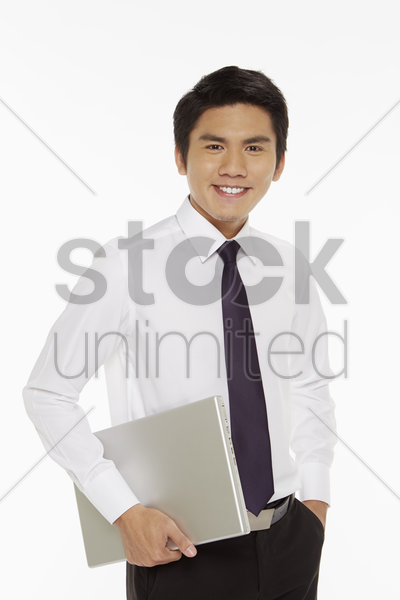businessman carrying a laptop stock photo