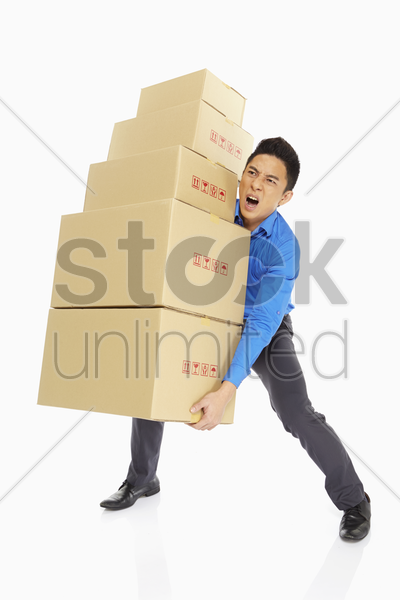businessman carrying a stack of cardboard boxes stock photo