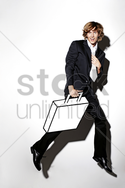 businessman carrying briefcase stock photo
