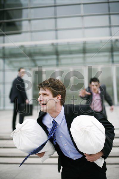 businessman chasing after a thief stock photo