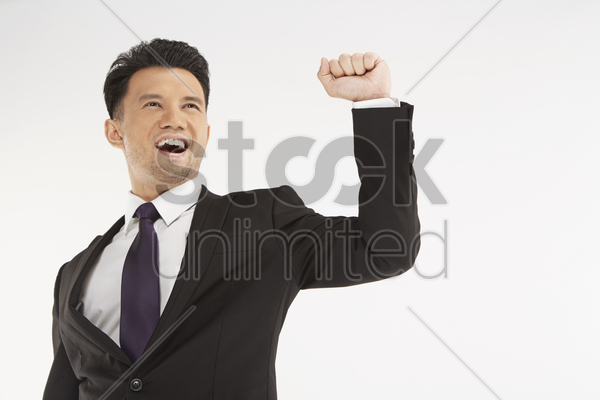 businessman cheering with fist in the air stock photo
