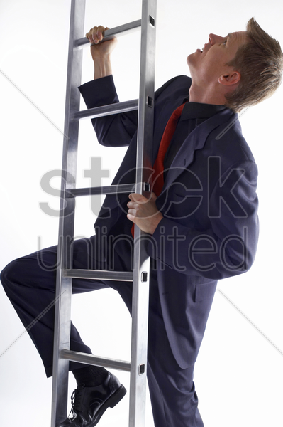 businessman climbing up the ladder stock photo