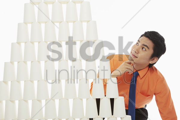 businessman contemplating stock photo