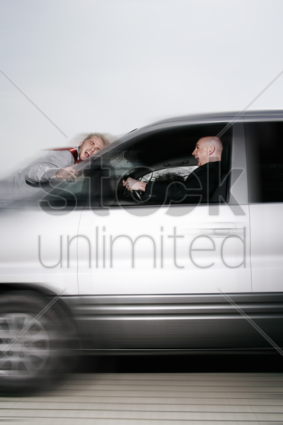 businessman crashing his car into a man stock photo