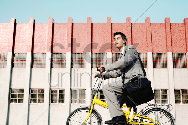 businessman cycling to work stock photo