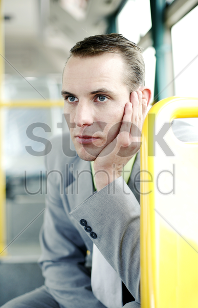 businessman daydreaming in the train stock photo