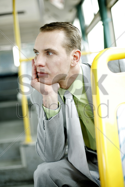 businessman daydreaming while sitting in the bus stock photo