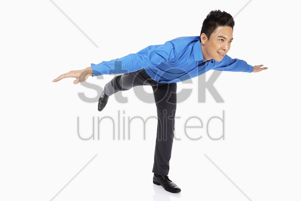 businessman doing a yoga pose stock photo