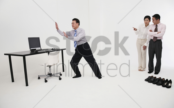 businessman doing tai chi in his office stock photo