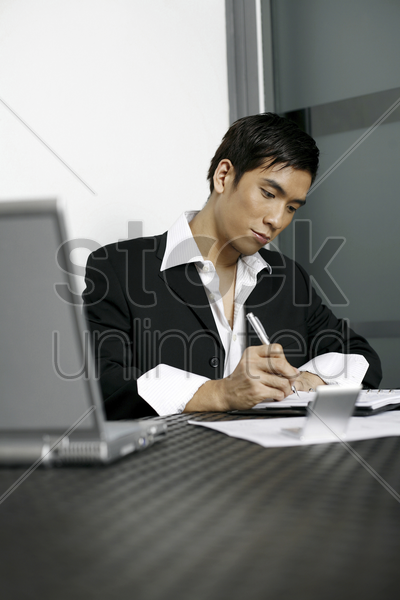 businessman doing work in the office stock photo