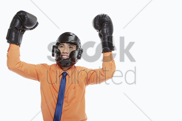 businessman dressed with boxing gear, cheering stock photo
