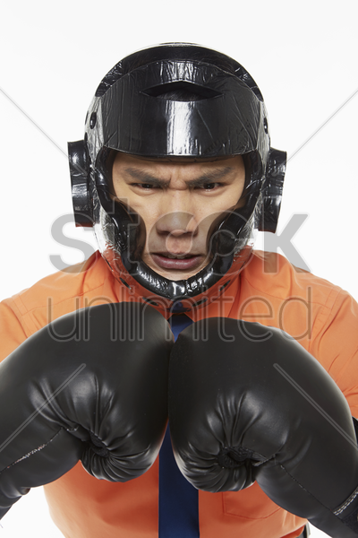 businessman dressed with boxing gear stock photo