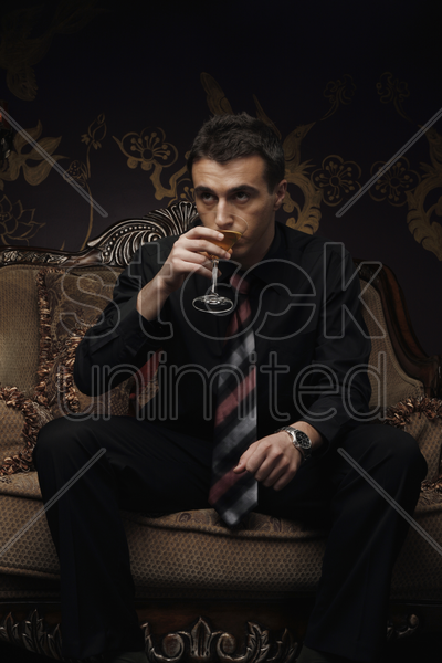 businessman drinking a cocktail stock photo