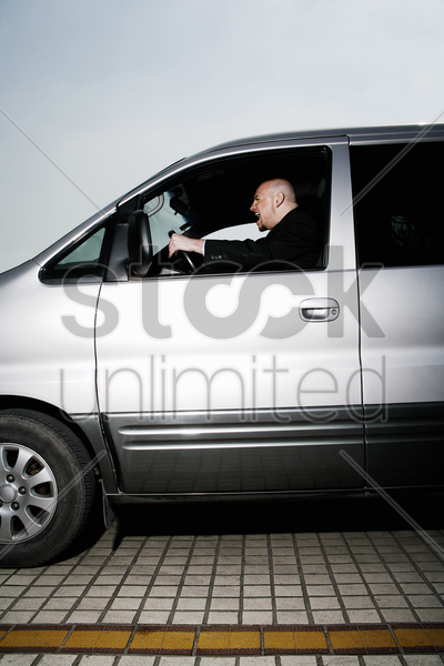 businessman driving aggressively stock photo