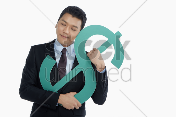 businessman embracing a dollar sign stock photo
