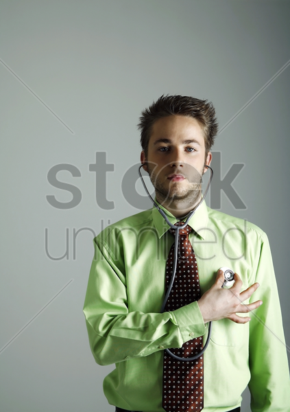 businessman examining himself stock photo