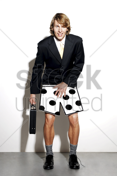 businessman feeling ashamed for wearing boxer shorts to work stock photo