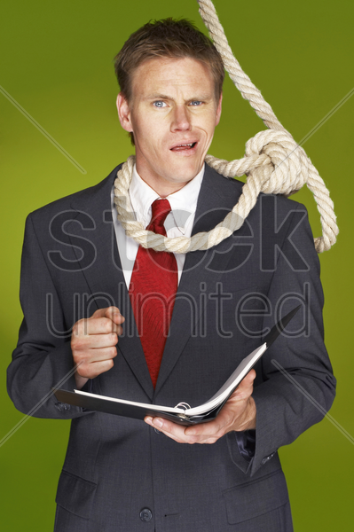 businessman feeling uncomfortable with a rope hanging around his neck stock photo