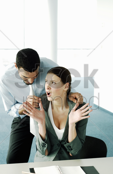 businessman flirting with his colleague stock photo
