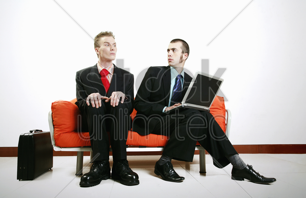 businessman getting irritated with his partner stock photo