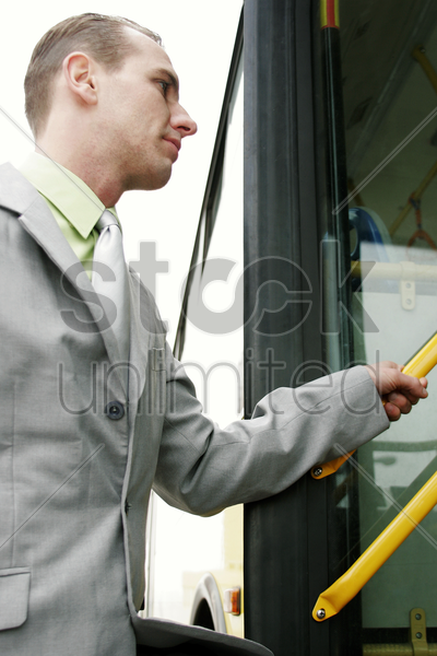 businessman getting on bus stock photo