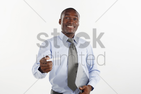 businessman giving business card stock photo
