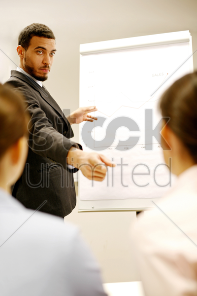 businessman giving presentation in the conference room stock photo