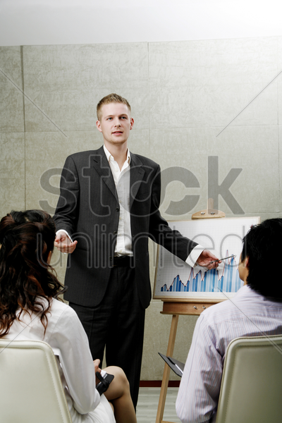 businessman giving presentation stock photo