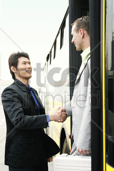 businessman greeting his client stock photo