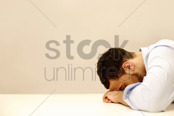 businessman grieving over his failure stock photo