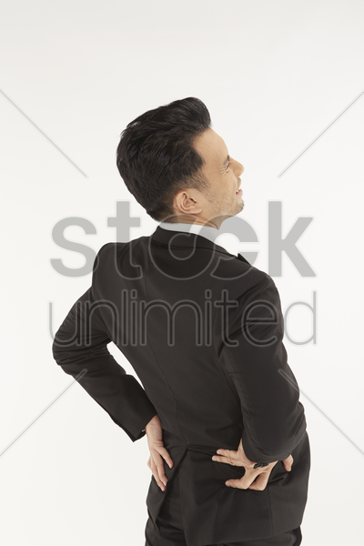 businessman having a back ache stock photo