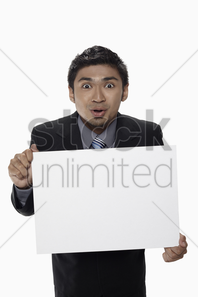 businessman holding a blank placard stock photo
