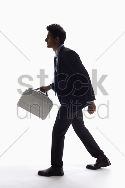 businessman holding a briefcase stock photo