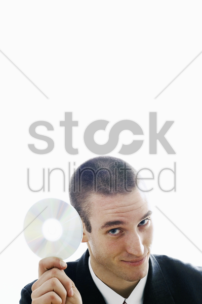 businessman holding a cd stock photo