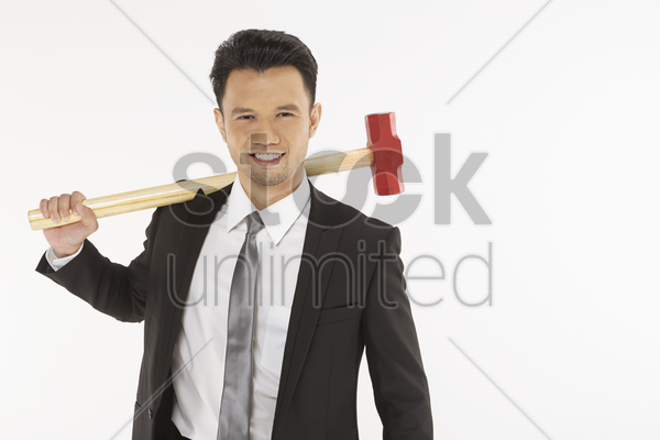 businessman holding a hammer stock photo