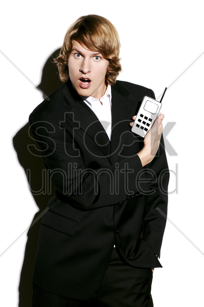 businessman holding a hand phone stock photo