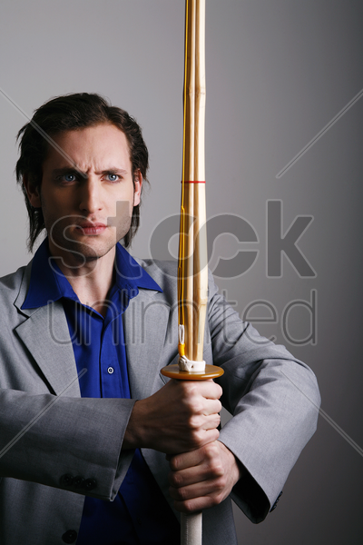 businessman holding a kendo stock photo