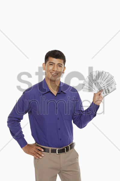 businessman holding a lot of money stock photo