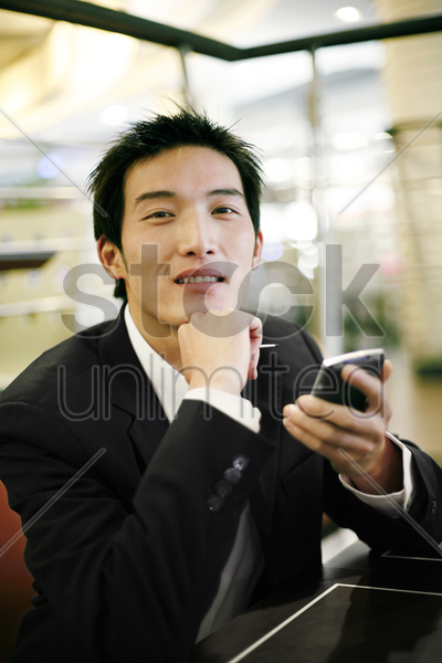 businessman holding a palmtop stock photo