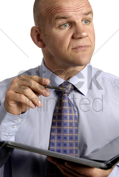 businessman holding a pen and a document stock photo