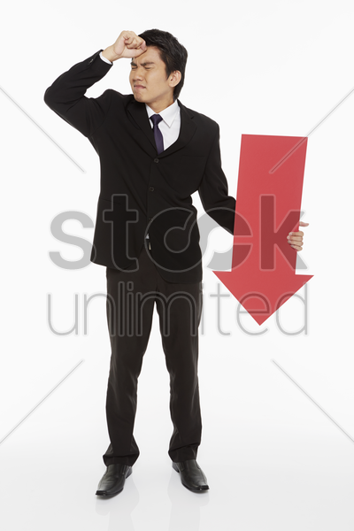 businessman holding a red arrow stock photo