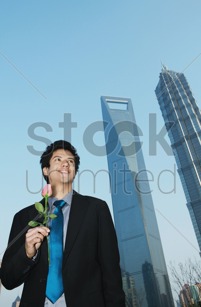 businessman holding a rose stock photo