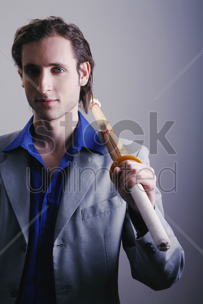 businessman holding a sword stock photo