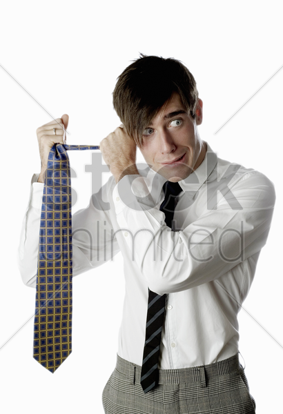 businessman holding a tie stock photo