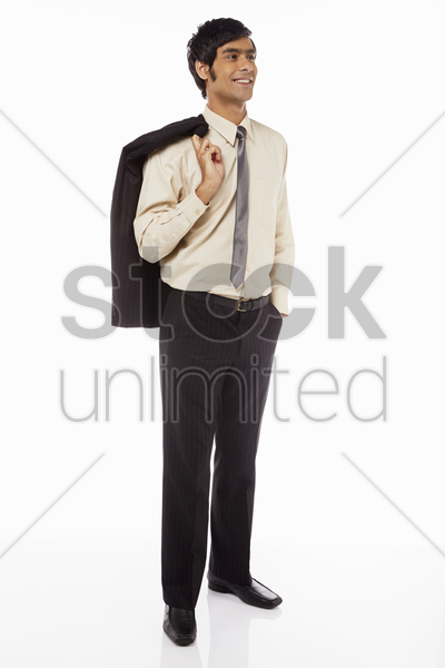 businessman holding on to jacket, smiling stock photo