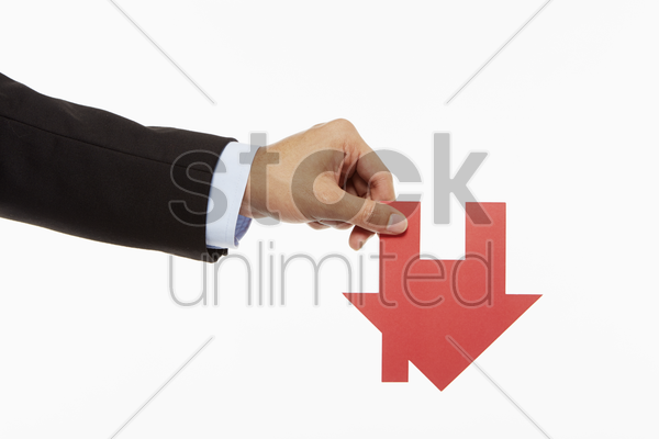 businessman holding up a cut out house stock photo