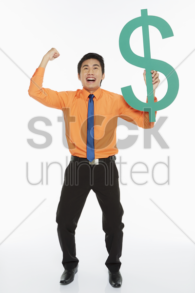 businessman holding up a dollar sign, cheering stock photo