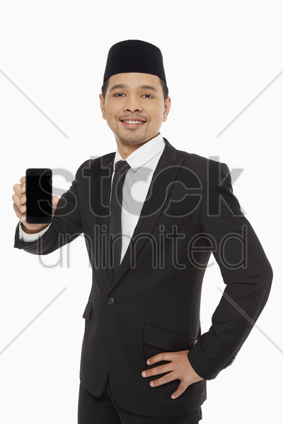 businessman holding up a mobile phone stock photo